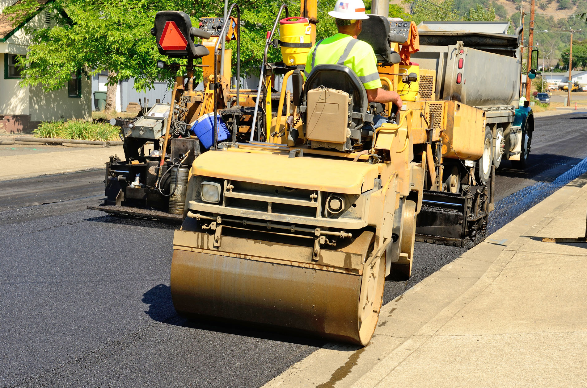APS Chipsealing and Paving asphalting a road with a roller